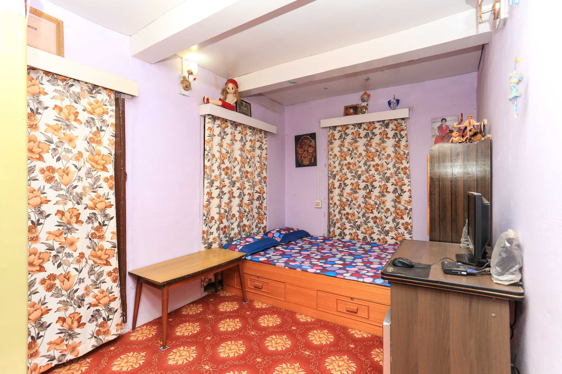 Room with a double bed at Palpa Community Homestay
