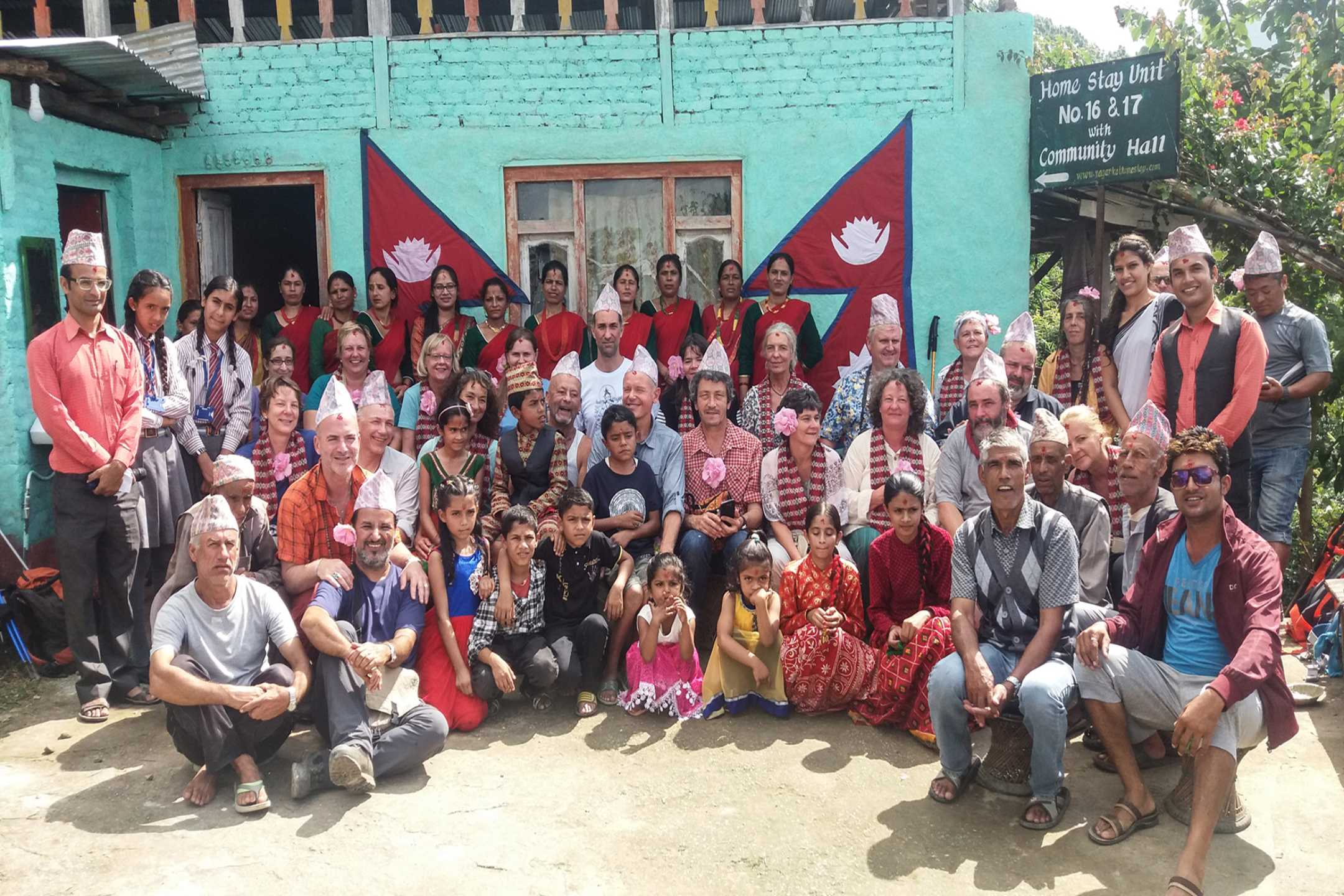 Families taking a picture with the guest at Nagarkot Community Homestay