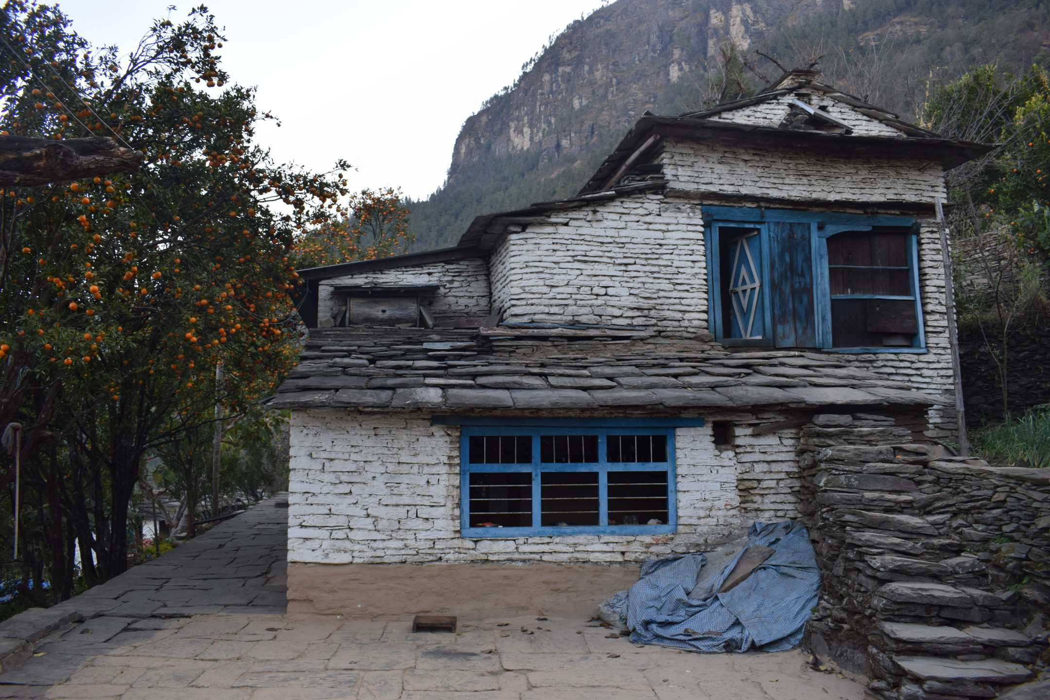 Community Lodge made in a traditional from stones and wood, a common architecture seen in the Himalayan regions of Nepal.