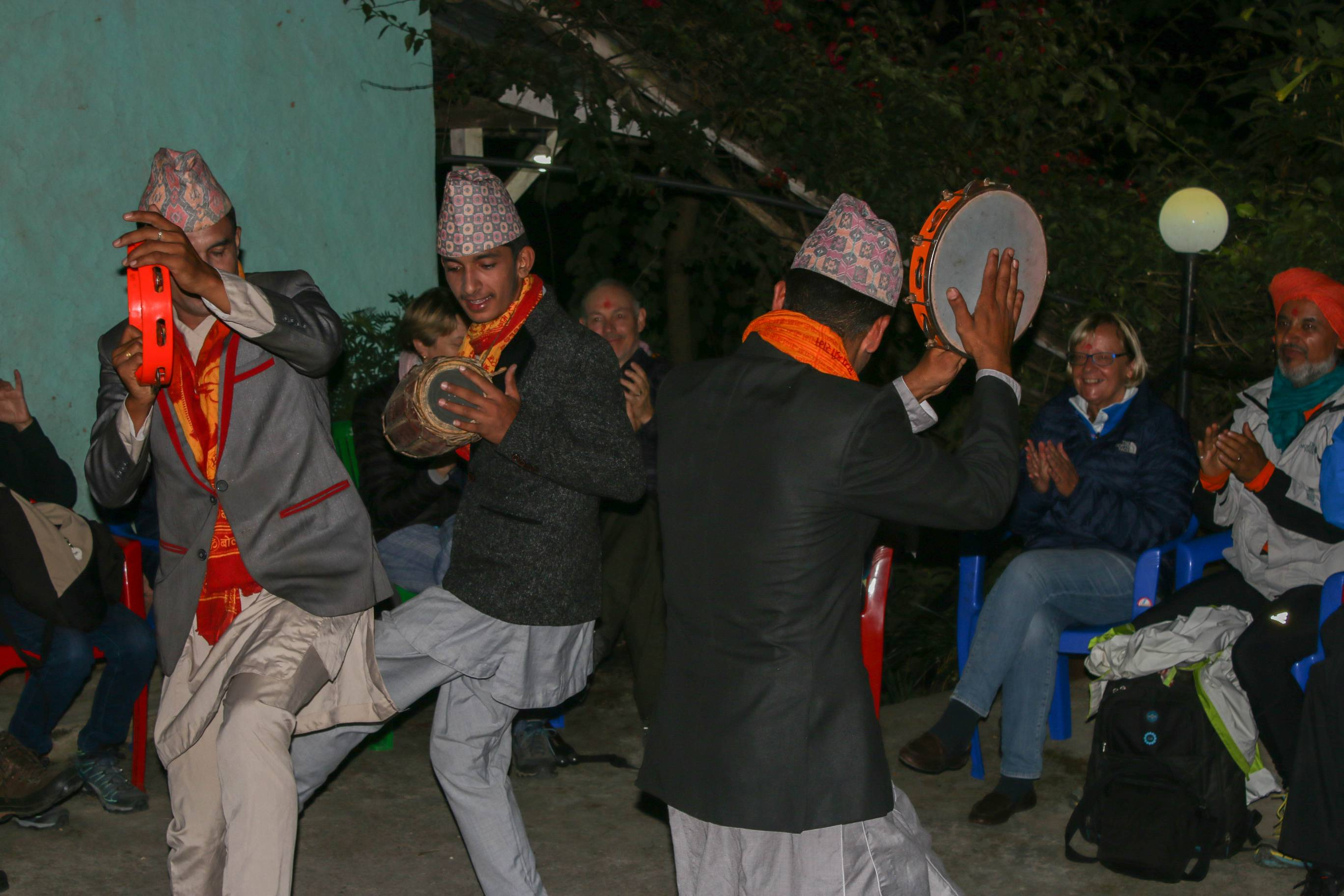 Men in traditional Nepali attire playing 'Maadal' and dancing to the tunes.