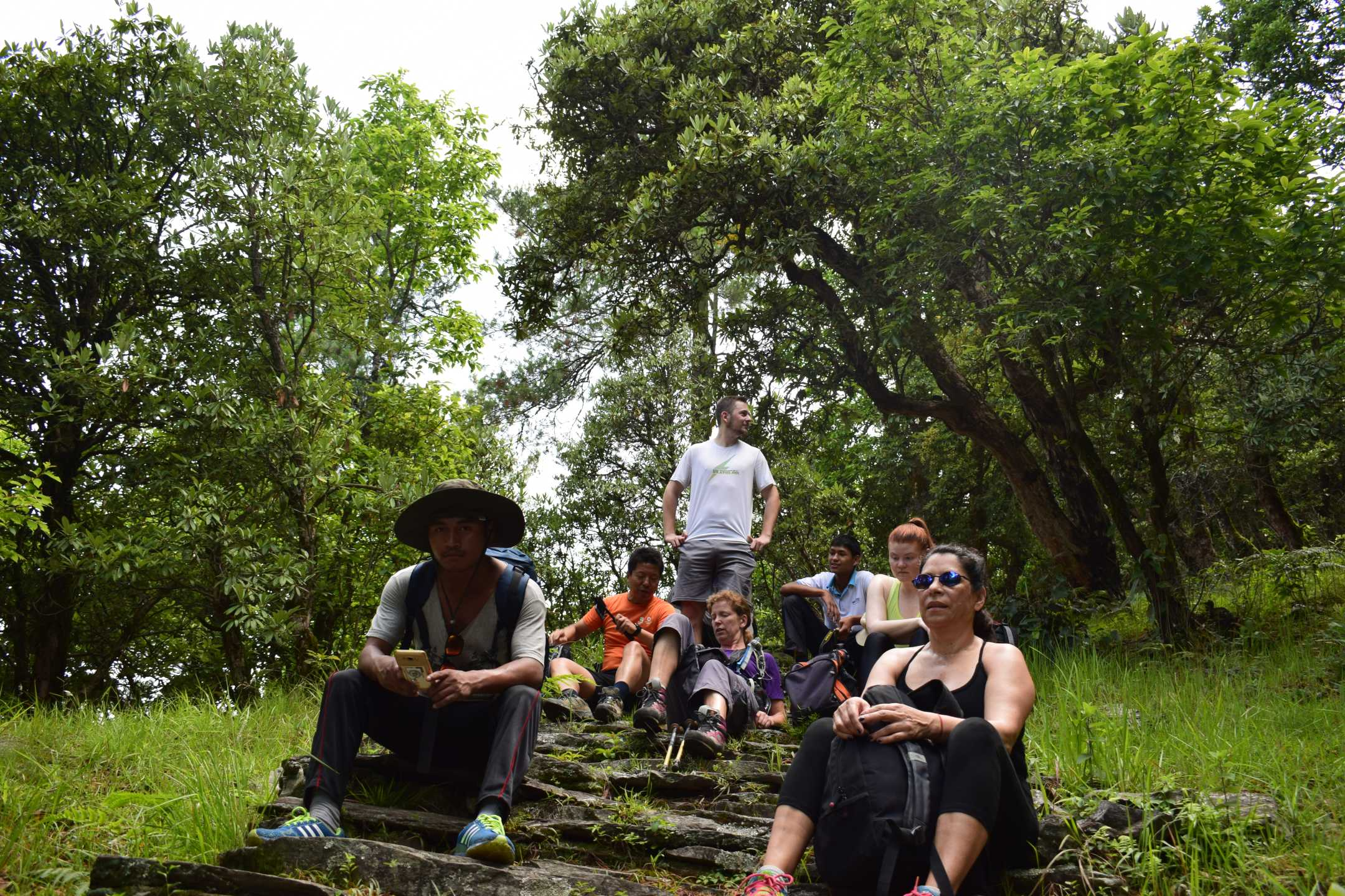 Trekkers on a break, climbing up hill from Danda Kateri to Nagi