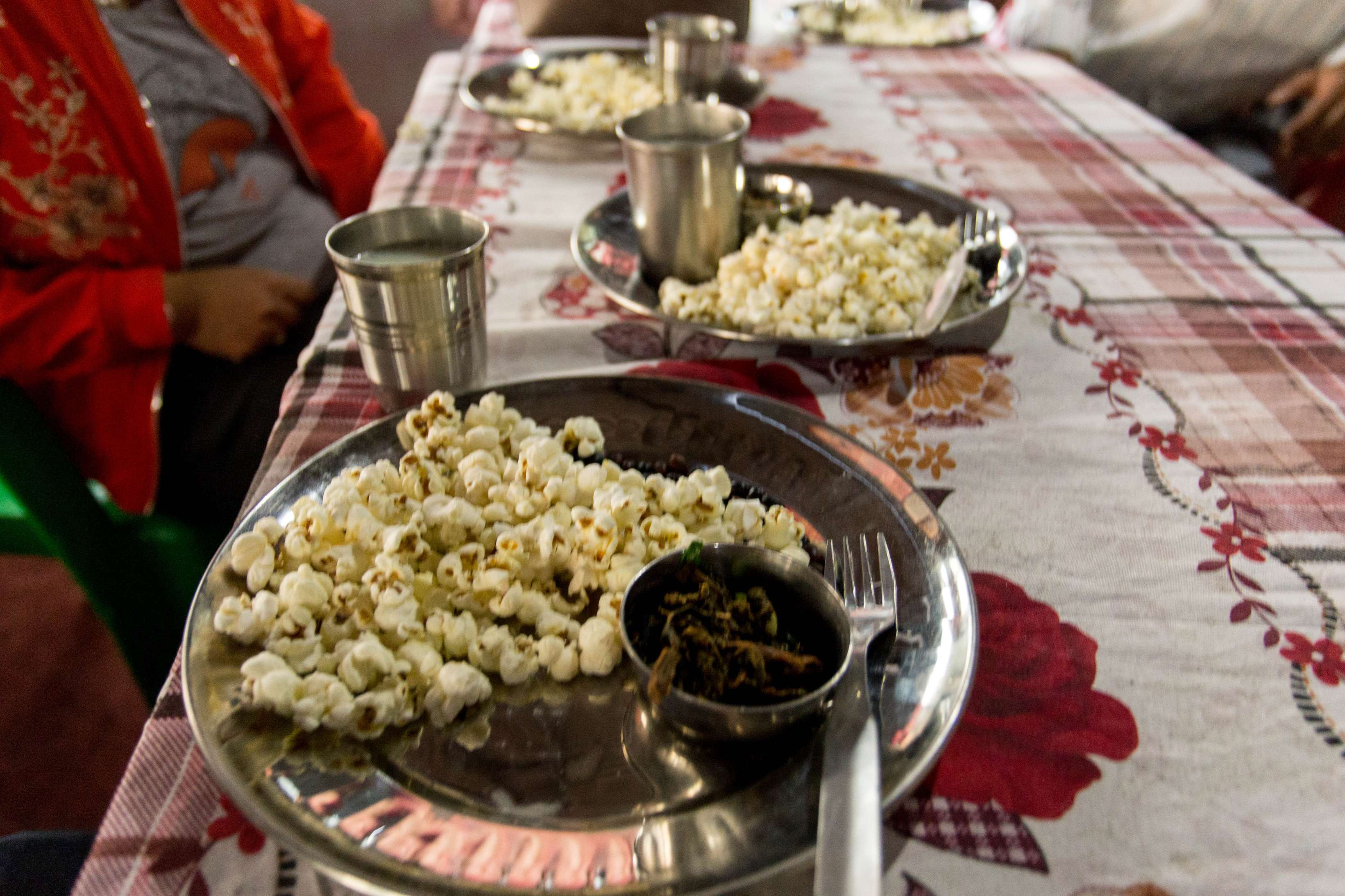 Popcorn with Gundruk and Tea, a common snacks in the villages
