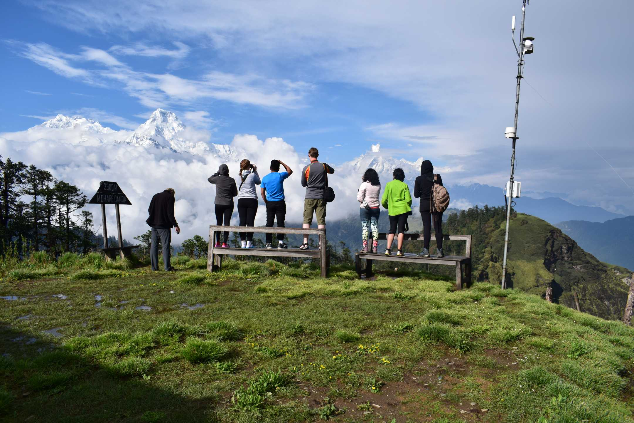 Trekkers Enjoying the panoramic views of  Himalayas, including Annapurna, Macchapucchre and Dhauligiri form Mohare Danda