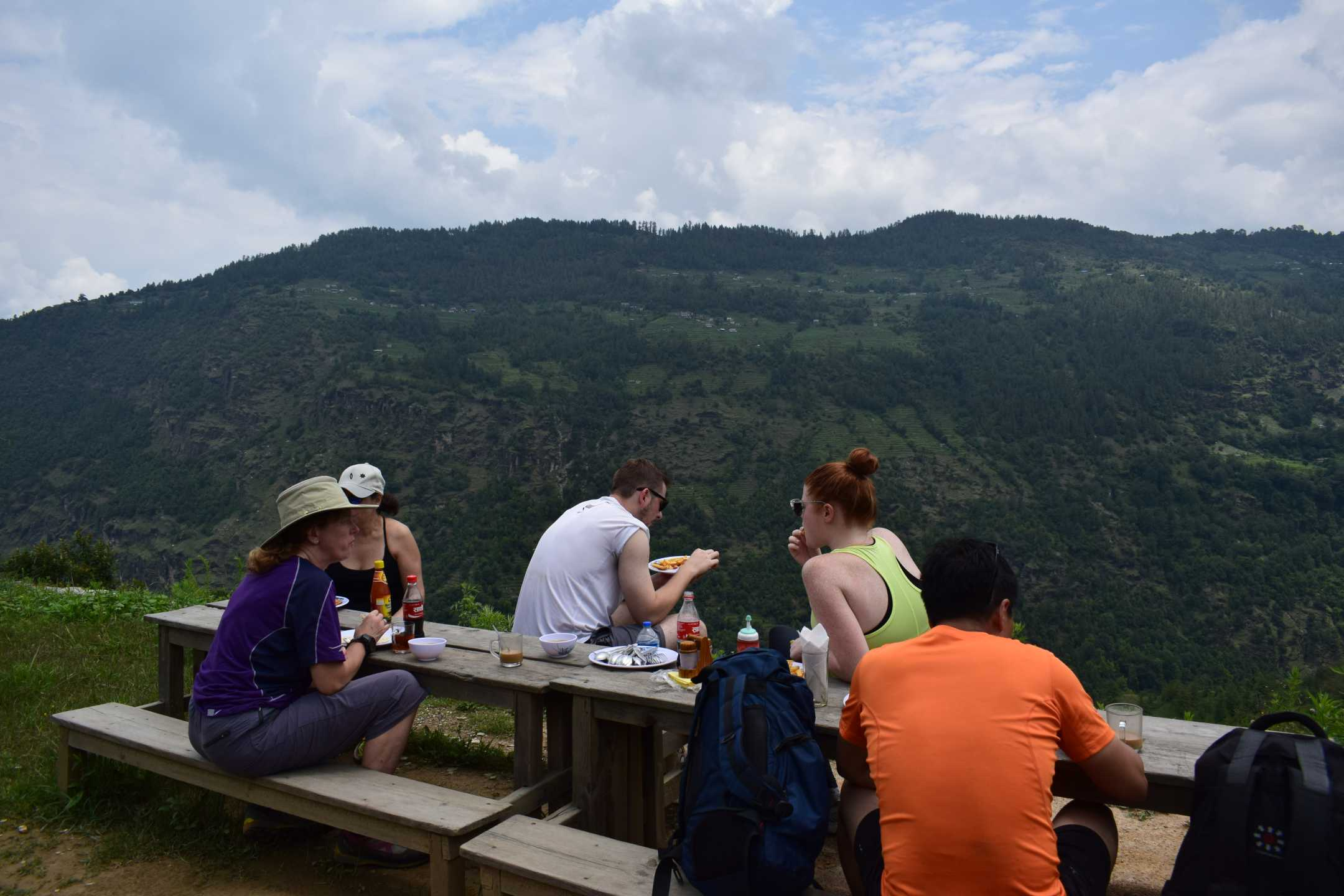 Trekkers enjoying food with a view