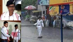 बारिश में ड्यूटी देती महिला ट्रेफिक पुलिसकर्मी बनी मिसाल, इंटरनेट पर तस्वीरें Viral