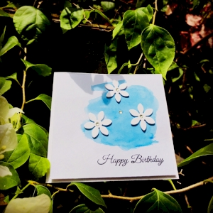 Handmade greeting card blue colour with flowers