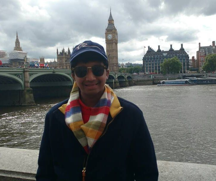 Mumbai high school student Vedant Podar near Westminster Bridge, London, with the Big Ben in the background, under a cloudy sky