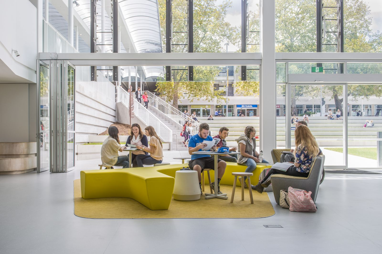 Students sitting in daylit atrium at Flinders University