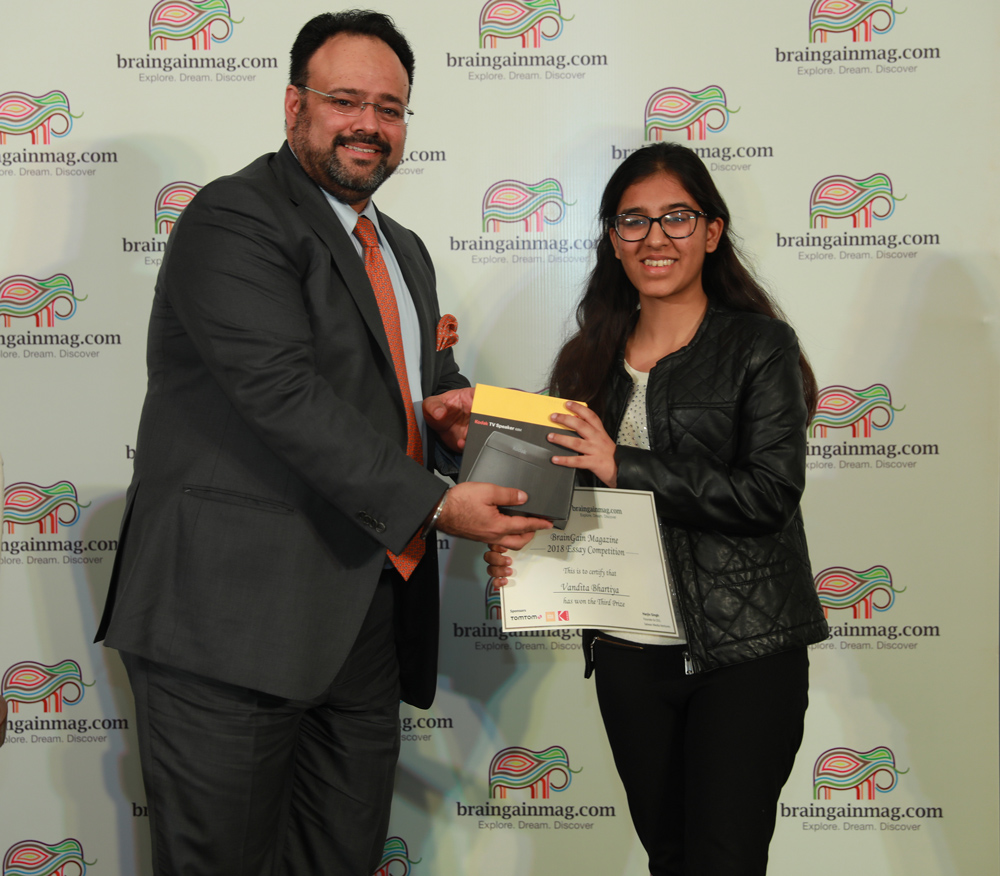 Vandita Bhartiya receives the third prize from Harjiv Singh, founder and publisher of braingainmag.com