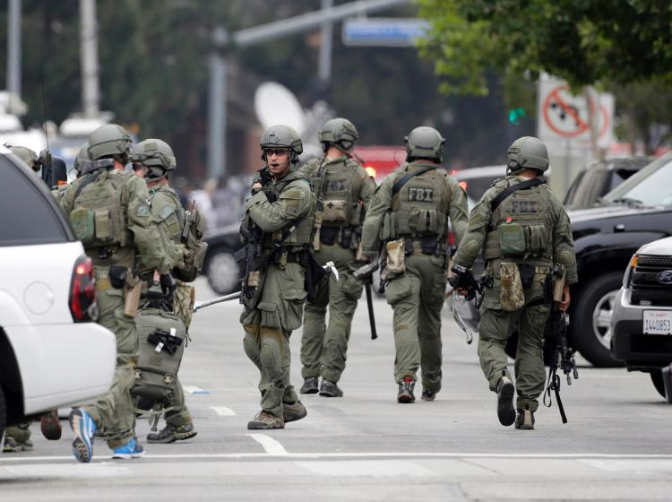 An FBI SWAT team arrives at the scene at UCLA after campus shooting