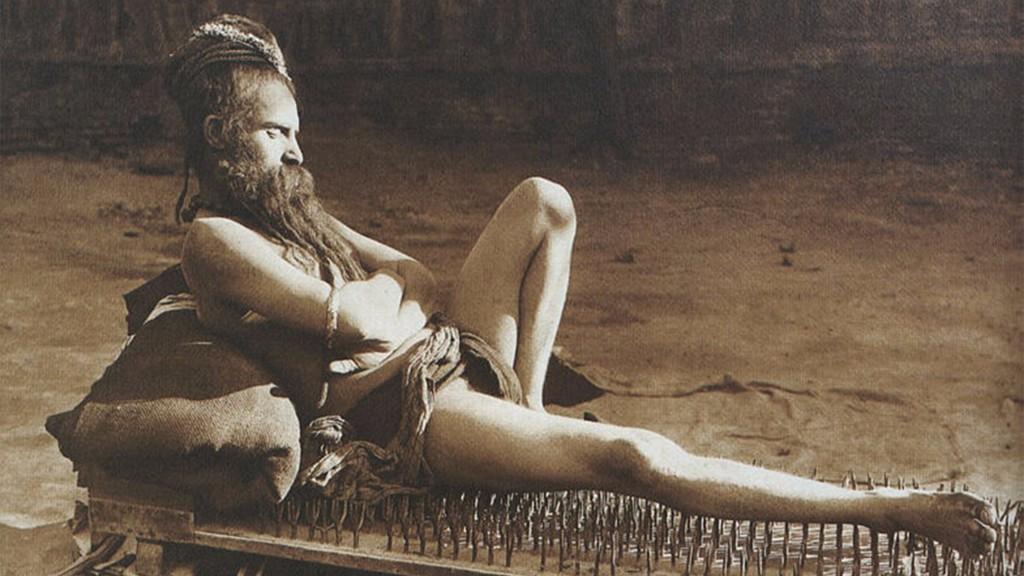 A Naga Sanyasi resting on a bed of nails