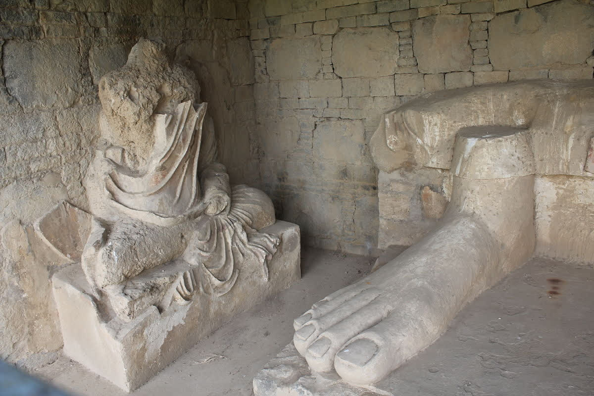 Stucco sculpture of Buddha and remnant feet of one of the largest stucco Buddha in Taxila   Muhammad Zahir