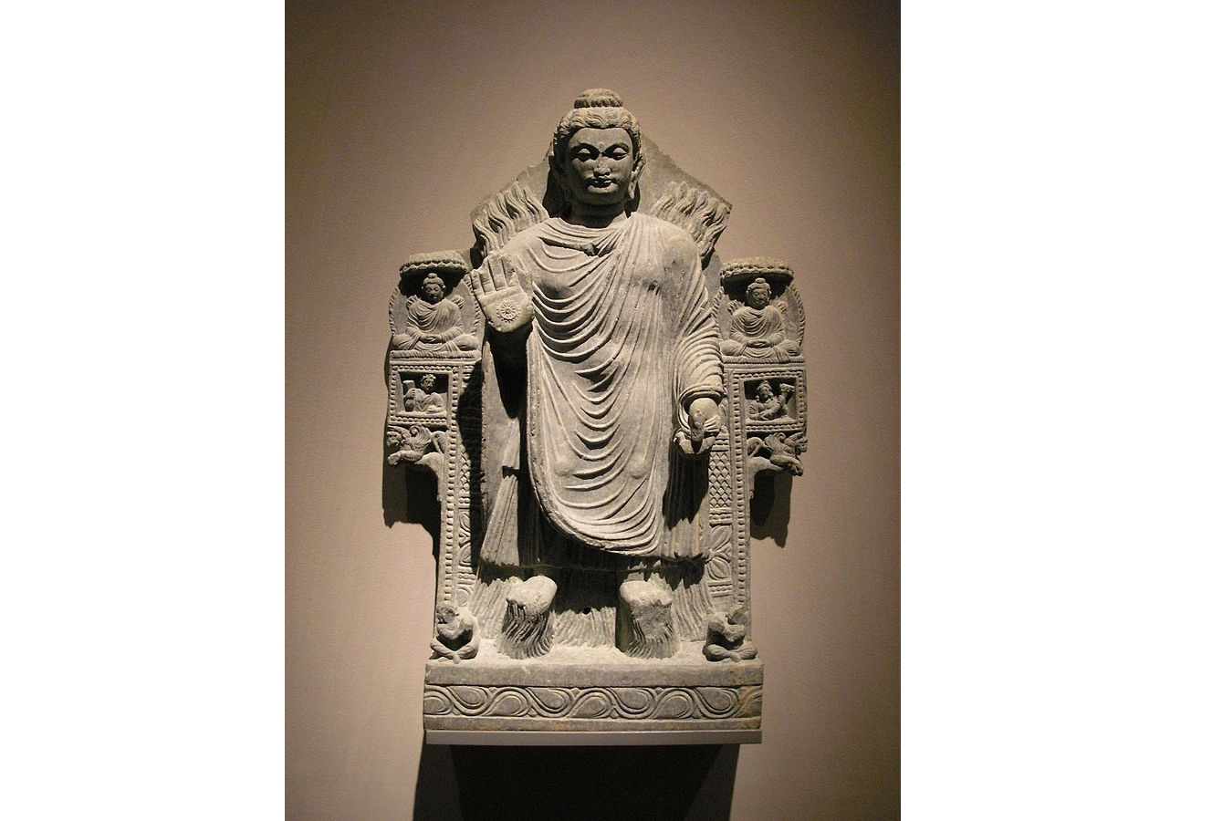 The Buddha shows miracles. Gandhara, 3rd century CE. Located in the Museum für Indische Kunst, Berlin-Dahlem