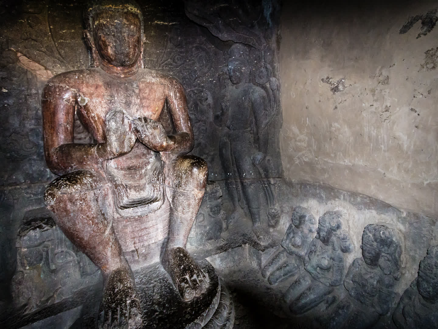 A seated Buddha sculpture in the caves