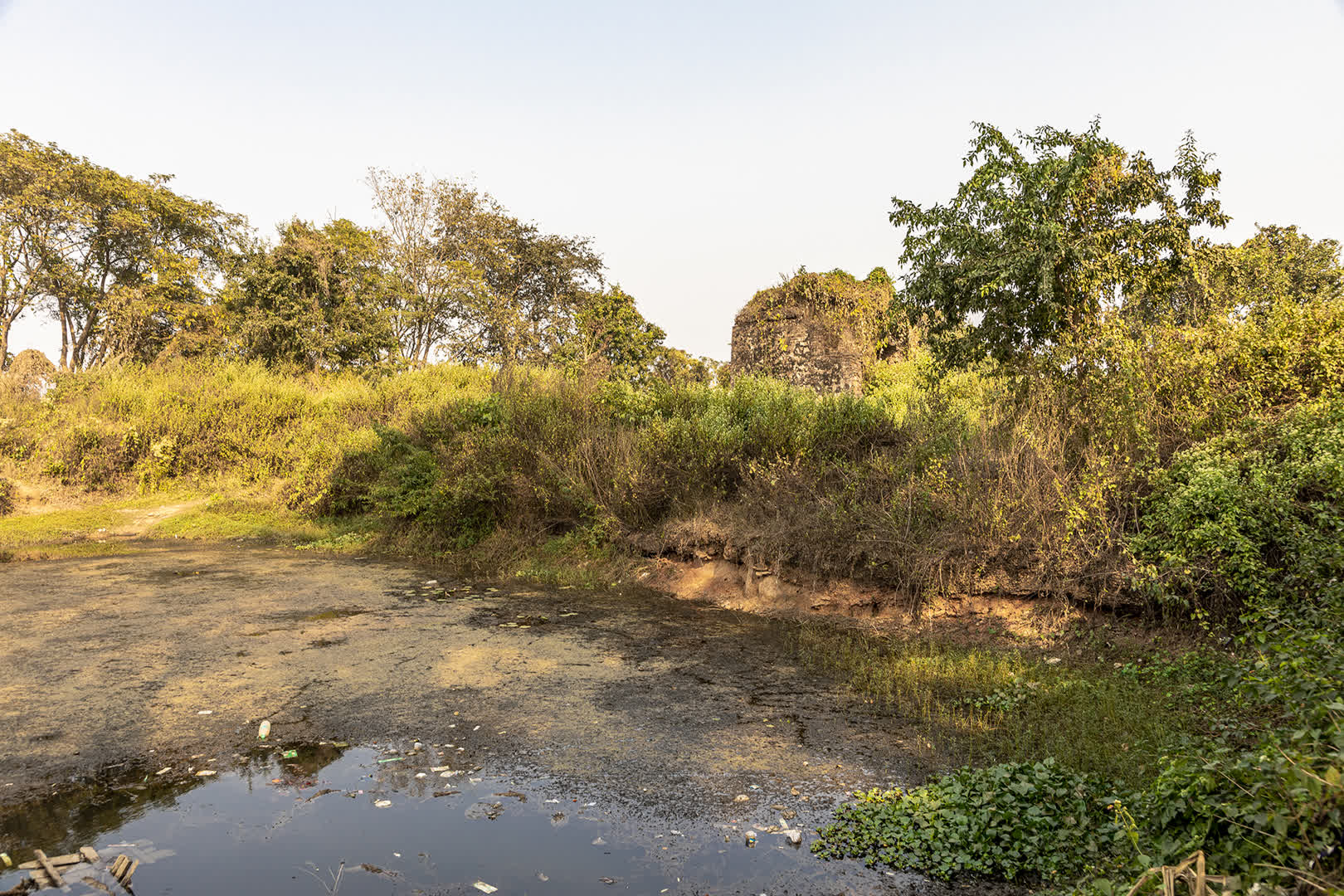 Ruins of Lal Bai's Palace in the distance and the pond she was drowned in