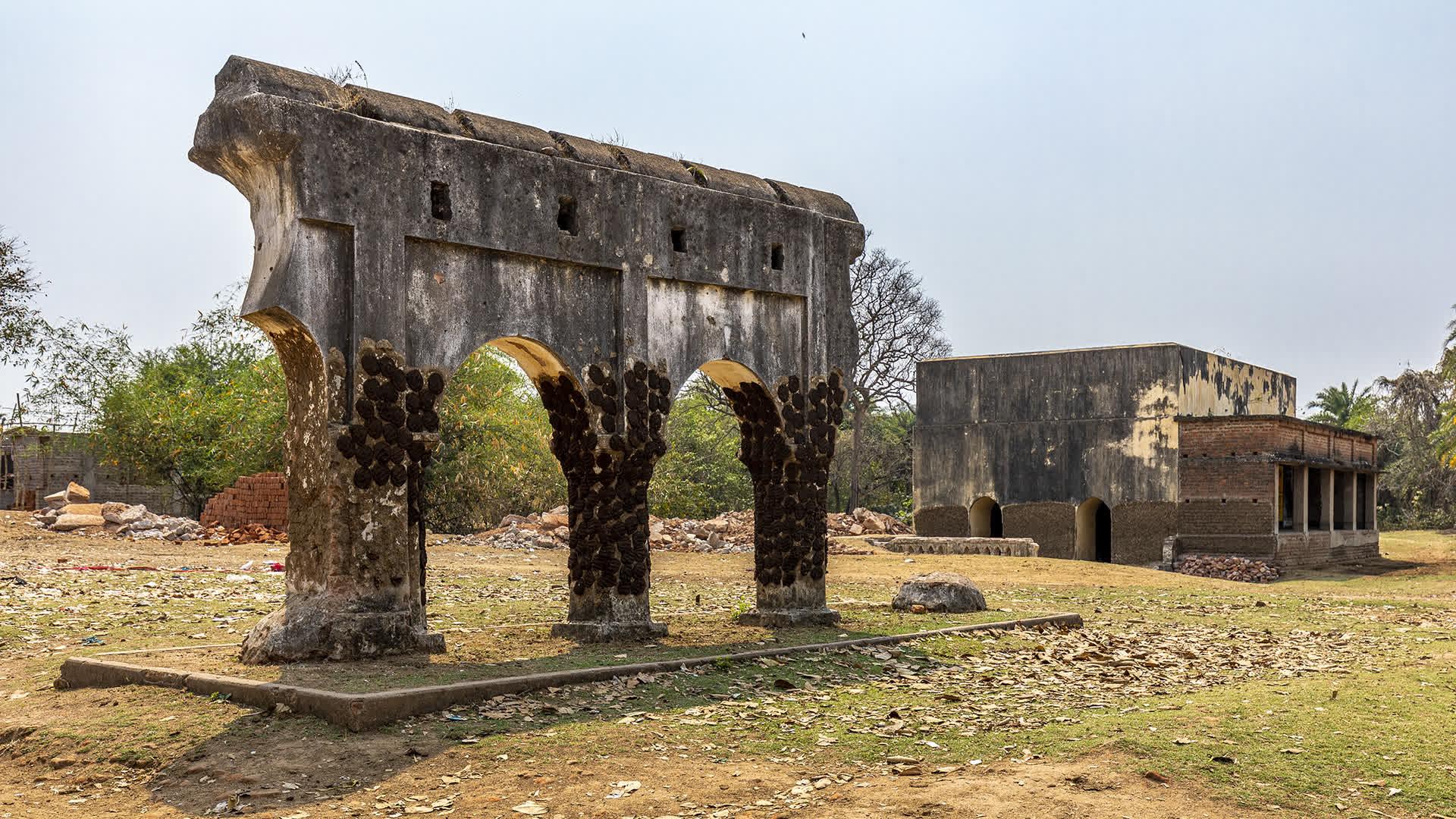 A Ruined Arch and the Rajnagar Gunpowder Magazine in the distance