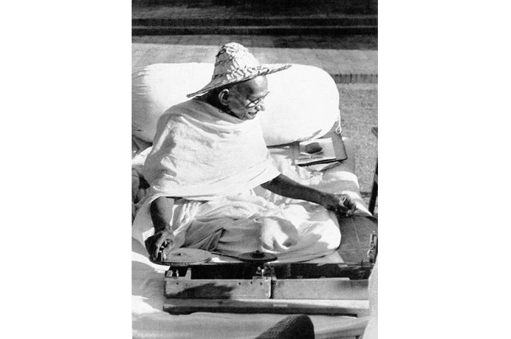 Gandhi, spinning in Noakhali