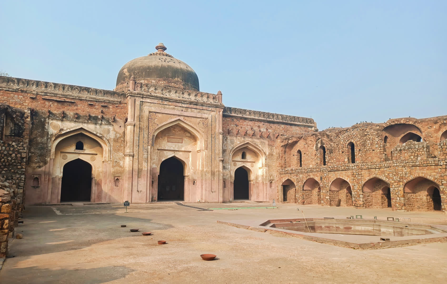 The Madrasa buildings with windows on the right