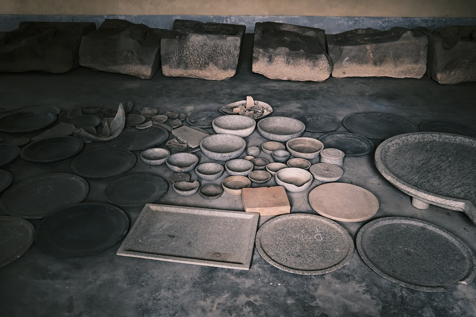 Utensils and sculptures recovered from the excavation