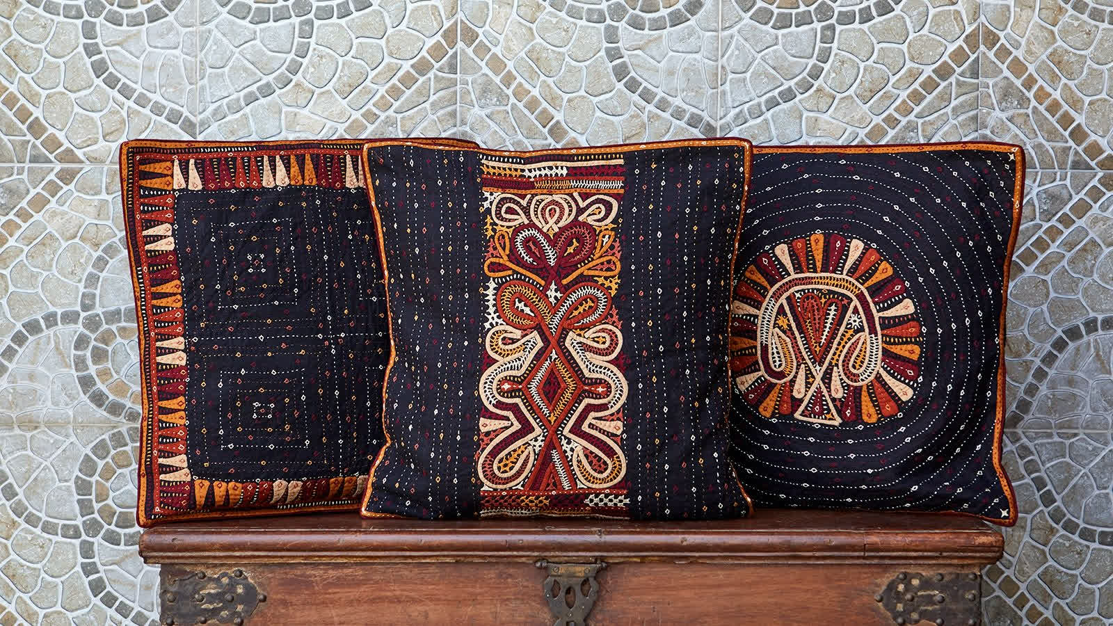 Cushion covers with Rabari embroidery, made by the artisans of Qasab   Peepul Tree