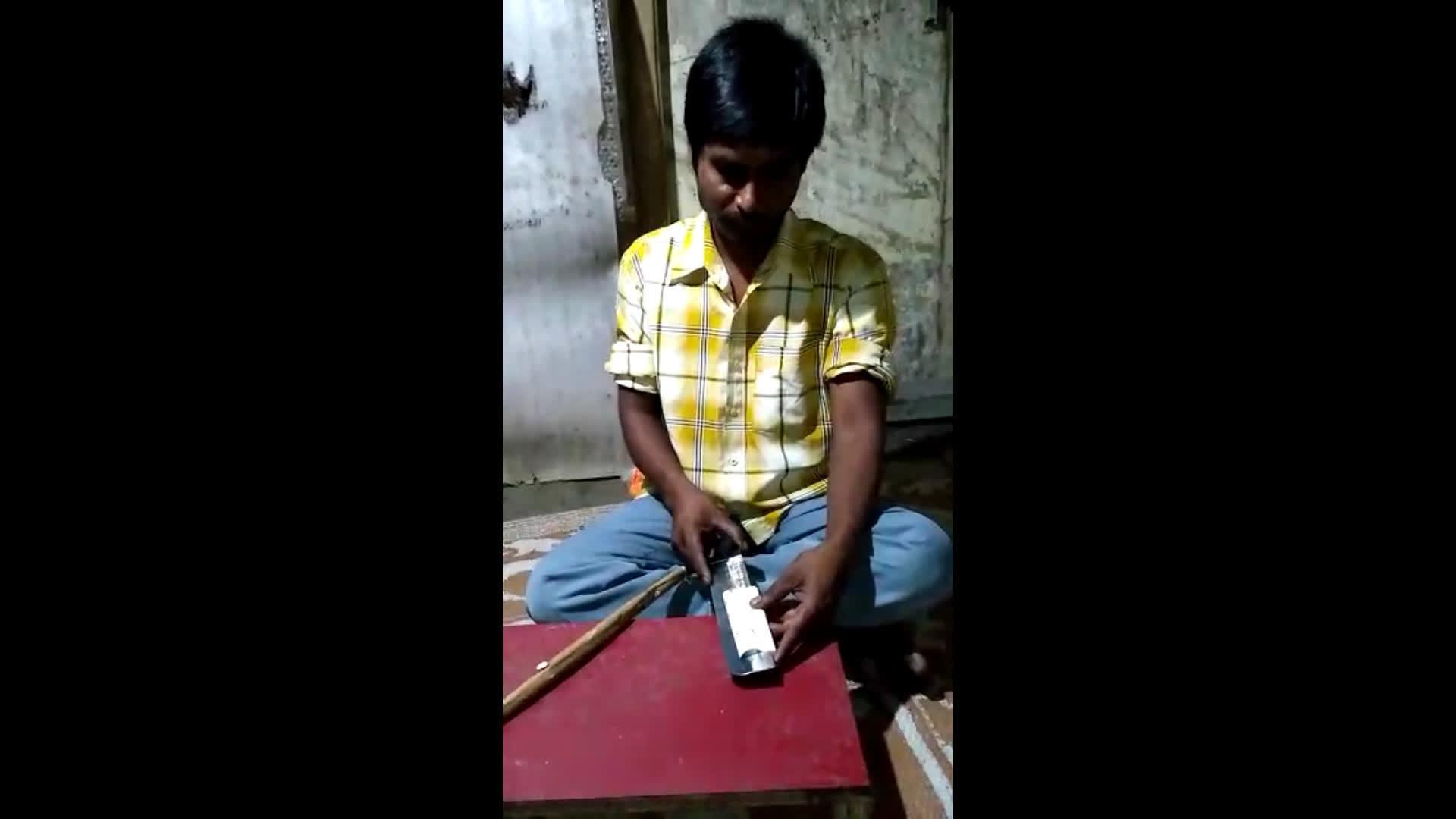 A Malakar making thin strips from Shola stem