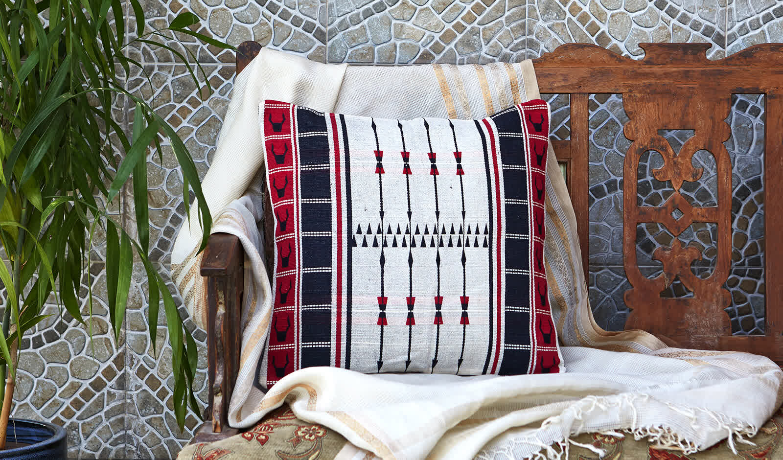 A cushion cover featuring the spear motif   Peepul Tree