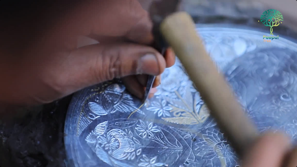Engraving the design on the metal