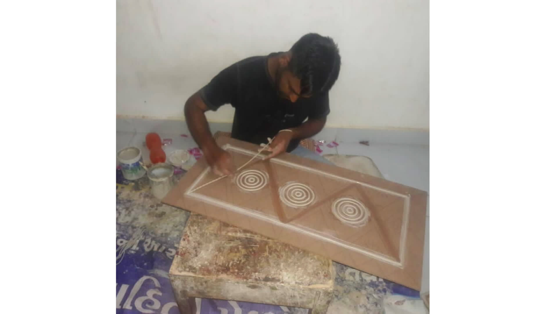 An artisan from Kutch working with the dough