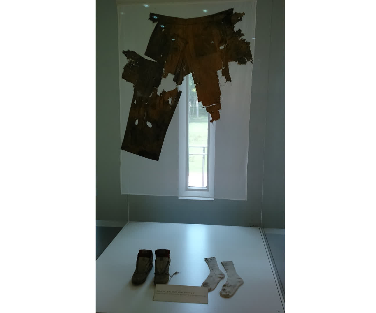 Remains of clothing worn by Rajiv Gandhi during his assassination | Indira Gandhi Memorial Museum, New Delhi