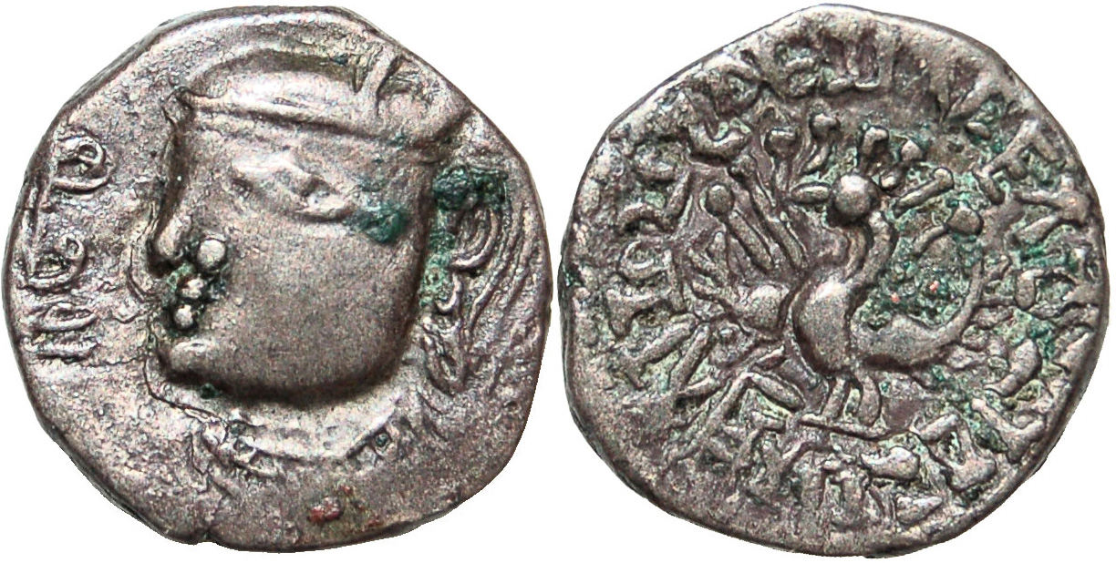 Silver coin of Toramana in Western Gupta Empire style, with the Gupta peacock and Brahmi legend