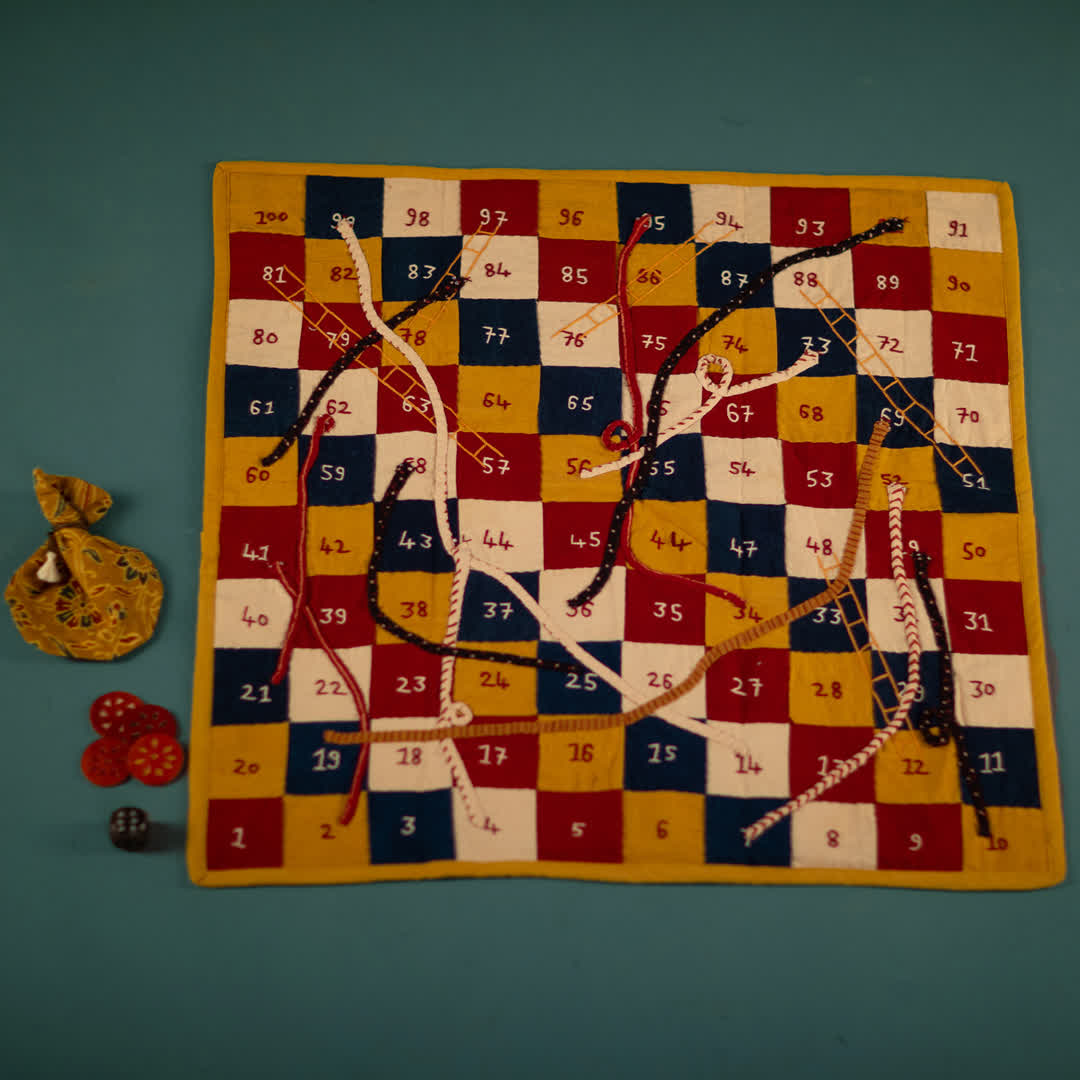 A traditional Snakes and Ladders set at Peepul Tree