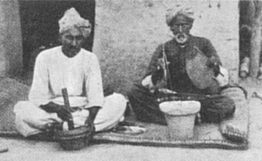 Making etched carnelian beads in modern times in Sehwan: one mixes the alkali formula in a mortar, while the other prepares a brasero (Mackay, 1933)