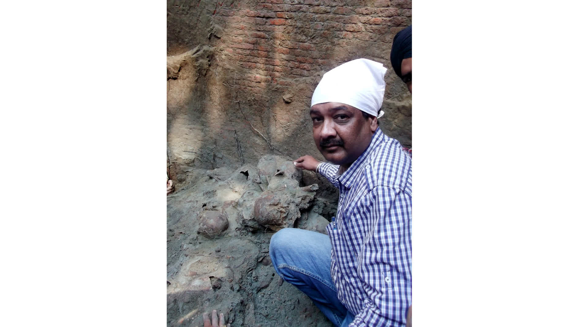 Historian Surinder Kochhar with the findings from the well