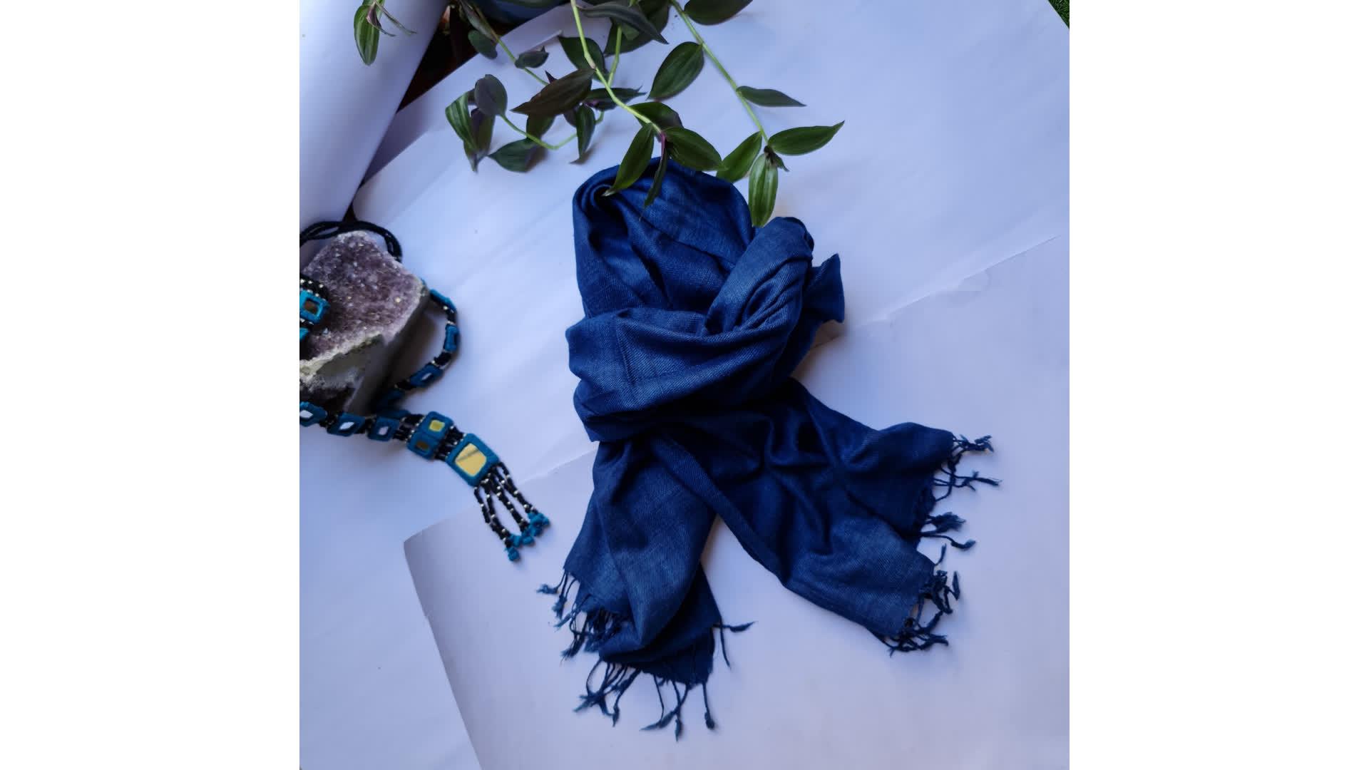 An indigo-coloured Eri Silk stole   Peepul Tree