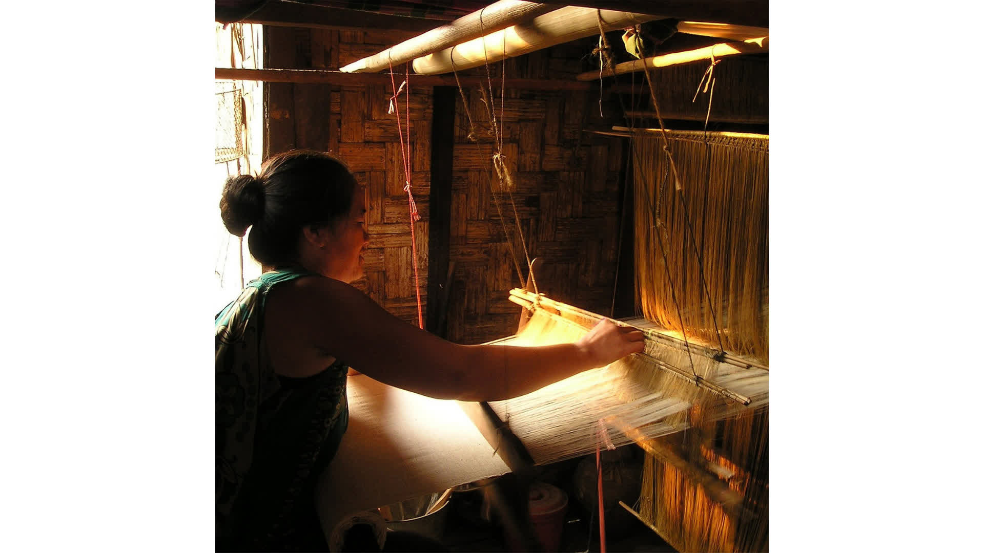 A woman engaged in weaving at Assam