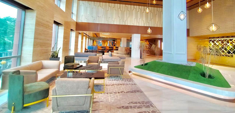 Grand double height lobby with informal seating space