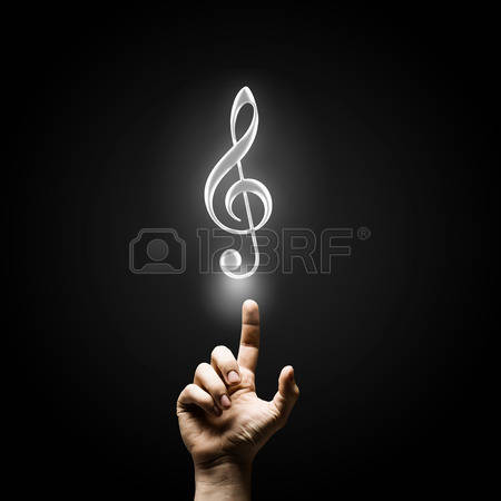 Male hand pointing with finger at music sign Stock Photo - 46346726
