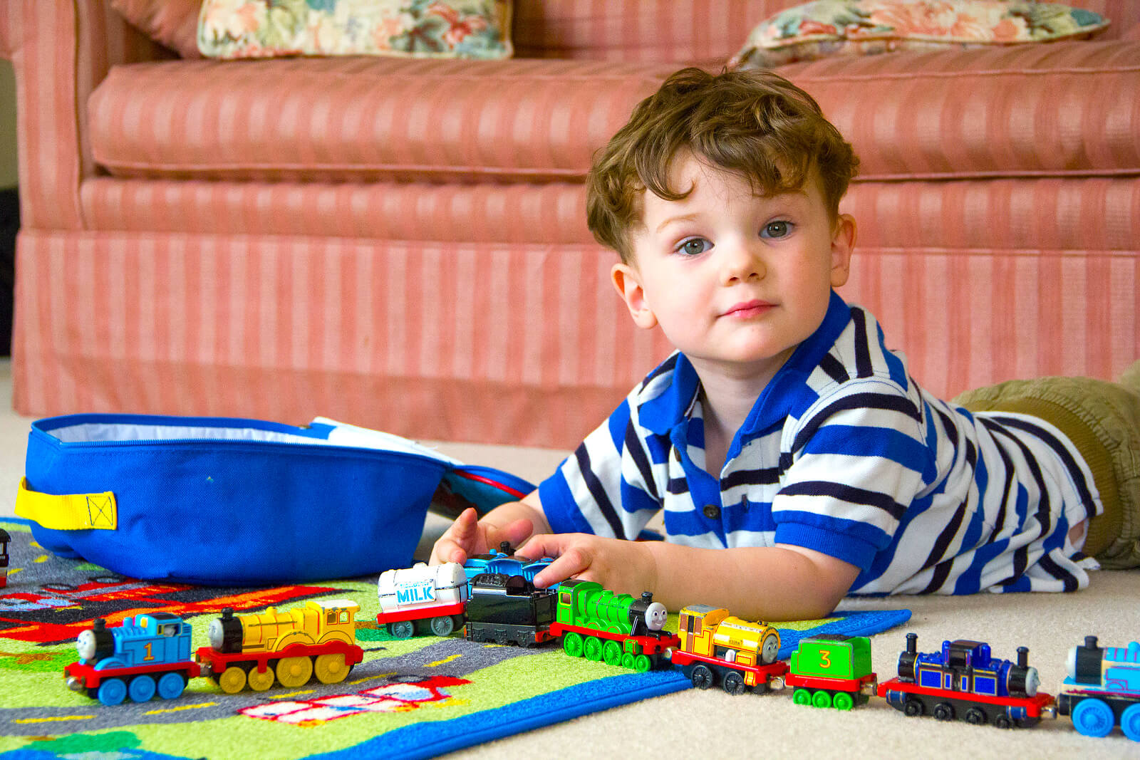 Boy with toy trains