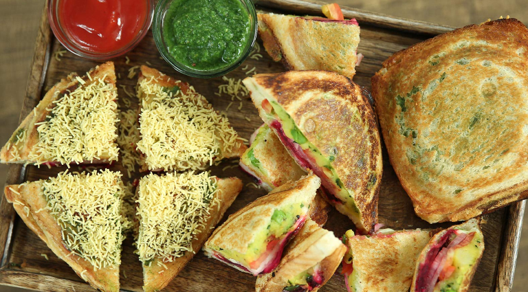 S.Kumar Sandwich Background