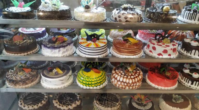 KM Leopard Cafe & Cake Shop Background