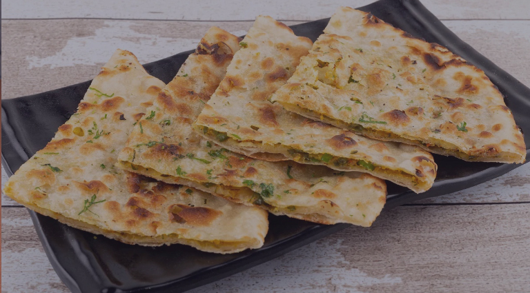 The Paratha King Background