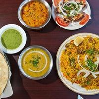 Shree Radhika Restaurant Logo