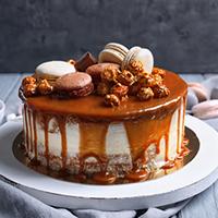 Deluxe Cake Shop & Snacks Logo