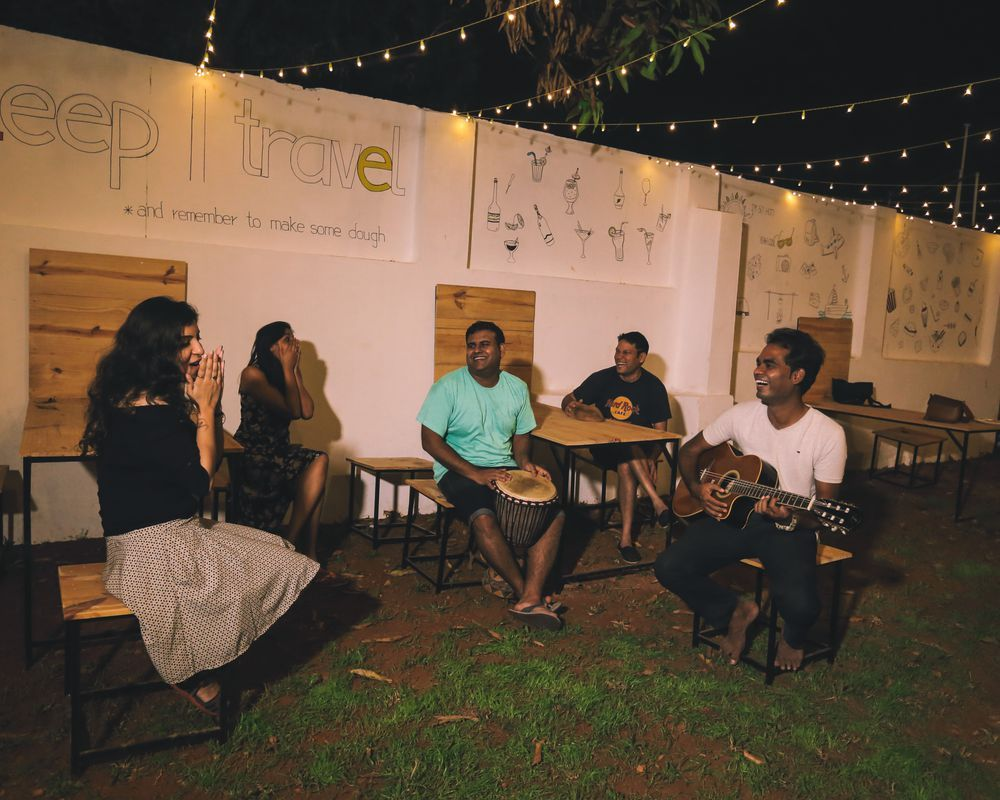 Travellers enjoying an impromptu jamming session at Zostel Alleppey