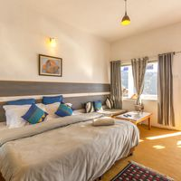 Big, cosy private rooms at our backpacker hostel near Nainital