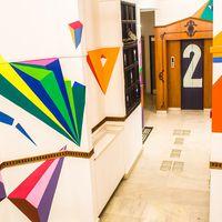 Geometric wall art on Zostel Delhi Corridors