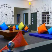 Vibrant common area with Pushkar Mela Murals in Pushkar Hostel
