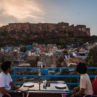 Travellers soaking in the view of Mehrangarh Fort from our rooftop cafe in Zostel Jodhpur
