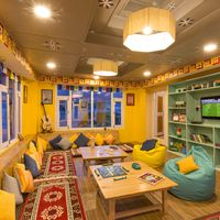 Board games, TV and relaxed seating space in Zostel Chitkul common room