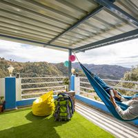 Traveller relaxing on hammock in Zostel Mukteshwar